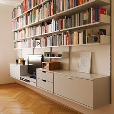 Living room storage for TV, DVD player, radio, pictures, books and games. Includes shelves, cabinets and drawers.