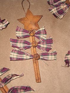 Prim Christmas Tree Ornaments...made from a cinnamon stick, homespun ties, & rusty jingle bells and star.