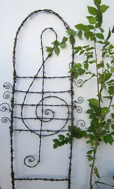Lovely Lyrical Treble Cleft Barbed Wire Garden Trellis - All About Diy Garden, Garden Trellis, Garden Gates, Barbed Wire Art, Music Garden, Trellis Design, Vintage Chandelier, Garden Structures, Wire Crafts