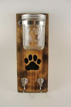 Dog lead holder with jar affixed to wooden plaque. Jar could be used for treats or poo bags? Rustic, DIY Dog lead holder with jar affixed to wooden plaque. Jar could be used for treats or poo bags? Animal Projects, Diy Projects, Dog Crafts, Wooden Plaques, Diy Holz, Diy Stuffed Animals, Mason Jars, Puppies, Crafty