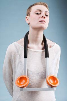 Sally Morrison - ECA (Edinburgh College of Art), UK - necklace, Space Oranges, 2013, breeze block, enamel paint, powder coated aluminium, neoprene, screws