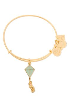 A playful charm in the shape of a free-flying kite decorates this slender gold bangle bracelet that expertly stacks and layers with similar pieces.