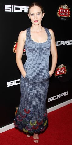 Emily Blunt arrived at the New York City premiere of Sicario at the Museum of Modern Art in a structural dress complete with pockets and colorful scalloped beading. Hot red lips and shoes completed the look.