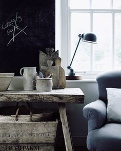 Vintage chopping boards and an armchair in the kitchen in the home of Michael Sinclair.