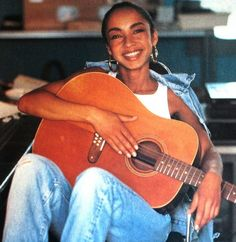 accras: A young Sade relaxing with guitar Quiet Storm, Easy Listening, Marvin Gaye, Beautiful Black Women, Beautiful People, Simply Beautiful, Sade Adu, Winter Typ, Her Music