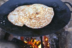 This is summer. The Finnish muurinpohjalettu, which translates more or less to 'griddle crepe', is prepared over an open flame, usually at the summer cottage. The thin crepe is served with strawberries and cream.