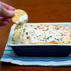 "RITZ White Pizza Meatball Dip, created by Lombardi's Pizza | ""This creamy, cheesy white pizza meatball dip is Inspired by New York City's famous Lombardi's Pizza. Easy to make, try it with pre-made meatballs or make your own and serve hot with RITZ crackers. This dip will become a staple at all of your get-togethers. Watch the video, then get John Brescio's recipe for RITZ White Pizza Meatball Dip."""
