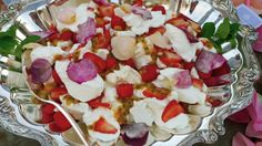 Pavlova with candied rose petals and passionfruit. Shout out to #slimpaley