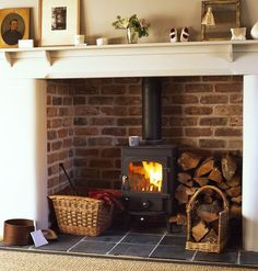 Wood burner in fireplace with log stack.  this is brilliant for old homes and nonworking fireplaces