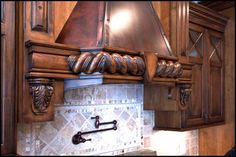 There is no limit to what Dixon Custom Cabinetry in Kernersville, NC can do! The detail in this Range Hood is amazing! #nolimits #detailiskey