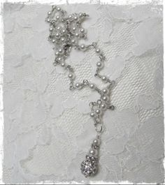 Perfect for a bride. Necklace is approx. 17 inches long. White pearls.