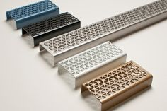 """[featimage align=""""left""""] Stormtech, the Australian inventor of linear shower drainage systems, has launched a new series of grates created in collaboration with internationally renowned designer, Marc Newson. Hexagon Pattern, Pattern Design, Form Design, Drainage Grates, Yard Drainage, Plasma Cnc, Linear Drain, Drain Cover, Metal Art"""
