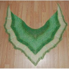 """The shawl is worked top-down and is a one-piece, symmetrical knit. Hold Mohair Glitter and 1 strand of green yarn together for the shawl body and just Mohair Glitter for the border. There are 12 cables total on the border. You can make it longer if you want to. Gauge is unimportant.Measurement Top edge 54"""" x 21"""" top to bottom Note : You can sell the finished item. Please credit me as the designer. If not, that is fine too. Thank you for knitting my pattern.Copyright Matters group - an…"""