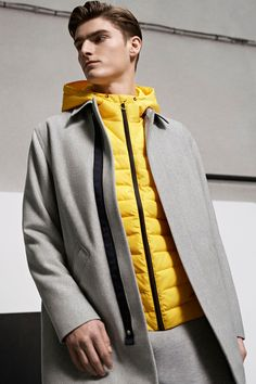 Alexander Beck is front and center in a light grey coat and yellow quilted jacket from Lacoste Live's fall-winter 2016 collection. Trendy Fashion, Mens Fashion, Lacoste Men, Quilted Jacket, Men's Collection, Cool Outfits, Fall Winter, Menswear, Street Style