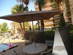 Rosen Inn at Pointe Orlando- Hotel com ótimo preço e localização | Disney de Novo International Drive, Sea World, Universal Studios, Walt Disney World, Pergola, Outdoor Structures, Outdoor Pergola