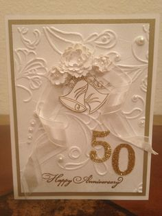 Anna Griffin embossing folder and white ribbon with wire;50th anniversary card