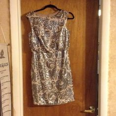 Adrianna Papell dress Nude and sequined dress. Worn once for a wedding. Runs true to size. Adrianna Papell Dresses Prom
