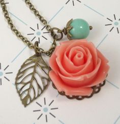Coral and Aqua Flower and Leaf Charm Wedding Bridesmaids Necklace. $14.00, via Etsy.