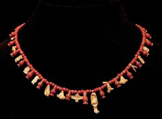 AN EGYPTIAN RED JASPER AND GOLD NECKLACE THIRD INTERMEDIATE PERIOD, 22ND DYNASTY, 945-712 B.C.