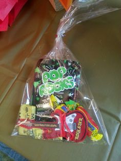 Stuff to put in the favor bags - candy from the 80s and 50s, electric guitar toy from dollar store.