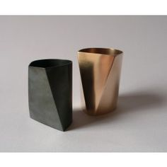 Oxidised sterling silver and gold plated silver beakers by Malin Winberg.