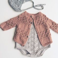 knitted onesie and cardigan
