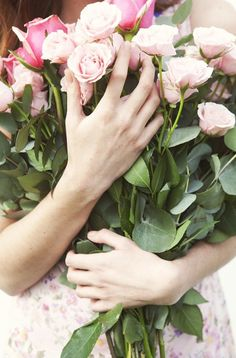 Holding roses..beautiful roses.............