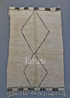 Paired-down Beni Ouarain rug. www.larusi.com