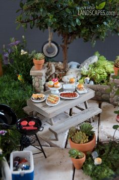 """""""Can't believe this is miniature - and a living garden!"""" Take a break on a rustic picnic bench with an amazingly real miniature food spread 