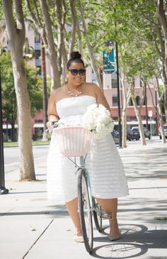 GarnerStyle | The Curvy Girl Guide: 7 Things You Need To Know About Riding Bikes - I love this dress and pic