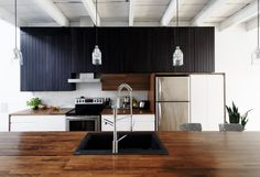 Unusual cool kitchen in Montreal by Naturehumaine Architecture and Desin