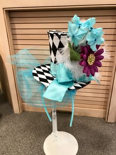 Second design for Alice in Wonderland Party. Here is a front side view of my design. The feathers are cut from a Dollar Tree $1 boa, headbands come 4 for $1 in assorted collars.