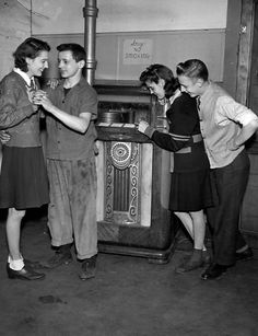 Teenagers dance by the jukebox at University Settlement in Cleveland, Ohio in 1944. Cleveland State University via Cleveland Memory.