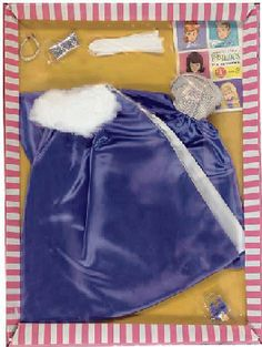 The matching cape is lined in white satin and has a large fur trimmed collar.       This ensemble was made in Europe in several different colors, including pink and red satin