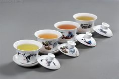 The rainbow of Chinese tea colours in gaiwans.