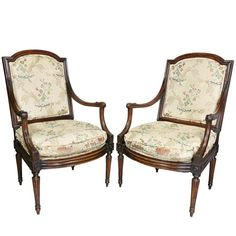 Pair of Italian Neoclassic walnut armchairs; each with an arched simply carved upholstered back and seat and downswept arms with scroll carved handholds, raised on circular tapered fluted legs headed by roundels. Circa h x w x d Seat height : Neoclassical, Armchairs, Accent Chairs, Carving, Pairs, Legs, Furniture, Lighting, Home Decor