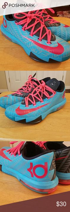 """Nike """"KD"""" Kevin Durant size 7.5 NIKE Kevin Durant low-mids in awesome shape these are unisex either guy or girls. My Daughter wore these for a bit and they show a little wear on the bottoms but other than that these in GUC. Nike Shoes Sneakers"""