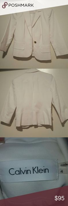 Calvin Klein - White Blazer - 3/4 Sleeve - Size 4 Sleek white blazer with a gold button on front (picture shows scuffs up close but can't really tell when wearing - still looks great!) Adorable detail in back and fits great!  Dry cleaned and free of stains! Got at Macy's - fyi the red tint you see in the pics is from my red floors reflecting onto the white Calvin Klein Jackets & Coats Blazers
