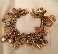 My charm bracelet ~ been collecting a very long time.