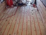 Great article on a hydronic heated floor and wall installation on a bus conversion. Lots of good information in this link.