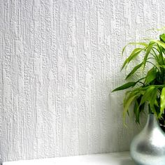 A beautiful rustic texture for walls. This unrefined design brings exceptional detail to walls as if artfully designed from a potters wheel. Enjoy our paintable wallpaper as an affordable solution for