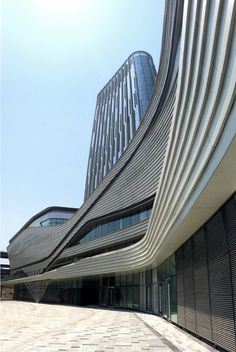 Incredible modern buildings in China only achived by great architects. For more inspirations click/press on the image. Arch Architecture, Organic Architecture, Contemporary Architecture, Unusual Buildings, Modern Buildings, Facade Design, Exterior Design, Mall Facade, Commercial Complex