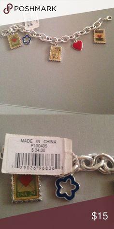 Bracelet A silver bracelet with pendants. Jewelry Bracelets