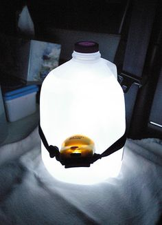 gallon milk jug filled with water with a headlamp pointing into the water. Great reading light for camping.