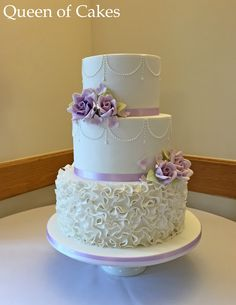 Lilac roses and white ruffles wedding cake by Queen of Cakes