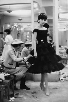 Coco Chanel putting finishing touches on yet another LBD, 1959.