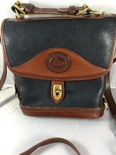Vintage Dooney & Bourke Pebbled Leather Black & Brown Shoulder Bucket Bag  #DooneyBourke #BucketShoulderBag