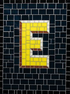 Mosaic Letter E- The Tieton Alphabet  Tieton Mosaic is a mosaic sign company in Tieton, WA specializing in typographic glass mosaic signage
