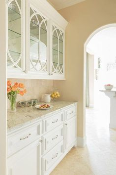 "Traditional Kitchen with Complex granite counters, One-wall, limestone tile floors, Crown molding, Stone Tile, Limestone Tile - Sherwin Williams ""Camelback"" Paint"