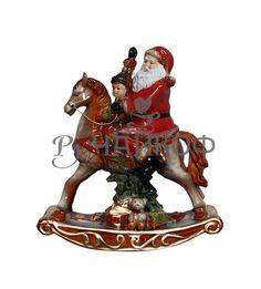 Дед Мороз на лошадке-качалке.